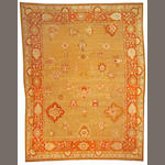 An Oushak carpet West Anatolia, size approximately 10ft. 2in. x 13ft. 2in.