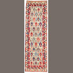 A Northwest Persian runner size approximately 3ft. 2in. x 10ft. 4in.