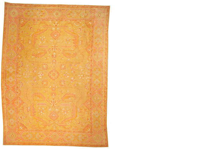 An Oushak carpet West Anatolia, size approximately 12ft. 2in. x 16ft. 4in.