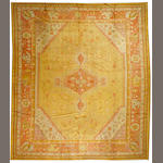An Oushak carpet West Anatolia, size approximately 13ft. 5in. x 15ft. 6in.
