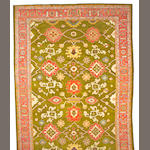 An Oushak carpet West Anatolia, size approximately 14ft. 6in. x 14ft. 10in.