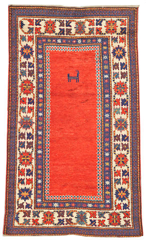 A Kazak rug Caucasus, size approximately 4ft. 7in. x 7ft. 10in.