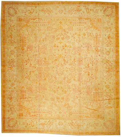 An Oushak carpet West Anatolia, size approximately 12ft. 10in. x 14ft. 6in.