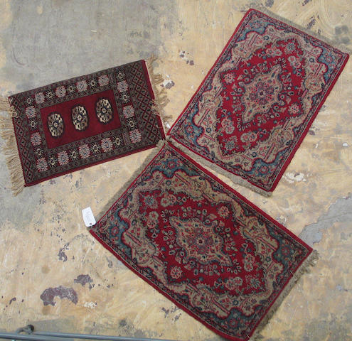 A pair of Kerman rugs and a small Pakistani rug