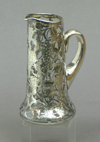 A sterling silver overlay glass pitcher