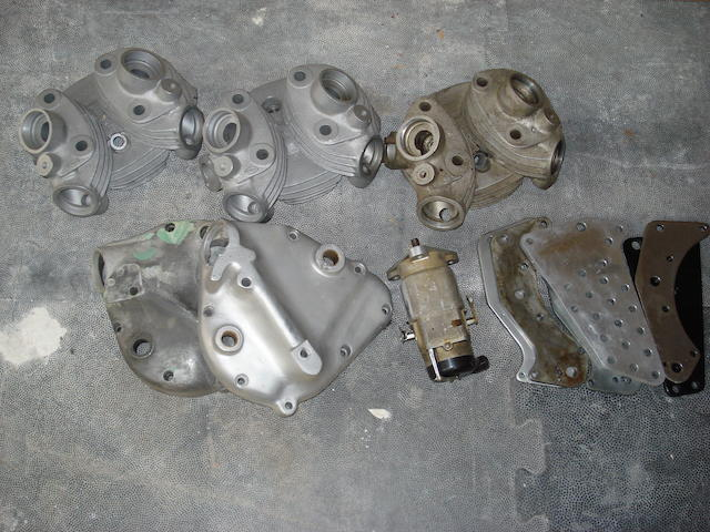 Three Vincent cylinder heads,