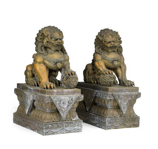 A pair of massive bronze seated lion dogs Republic Period