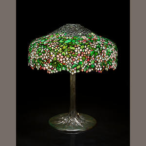A fine Tiffany Studios Favrile glass and bronze Apple Blossom table lamp