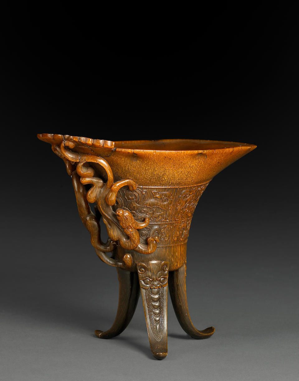 A fine and rare carved rhinoceros horn libation cup 17th/18th Century