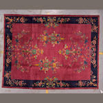 A Chinese carpet China, size approximately 9ft. x 11ft. 7in.
