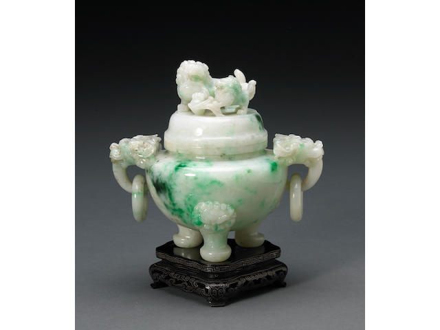 A green and apple green highlight jadeite tripod censer, fu dogs finial and loose ring handles design