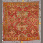 An Oushak carpet West Anatolia, size approximatley 5ft.4in. x 5ft. 9in.