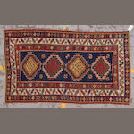 A Kazak carpet Caucasus, size approximately 4ft. 4in. x 7ft. 6in.