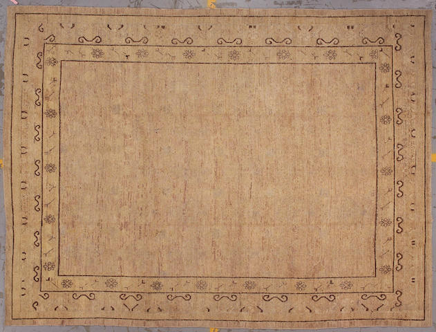 A contemporary Khotan carpet Turkestan, size approximatley 8ft.  x 10ft. 10in.