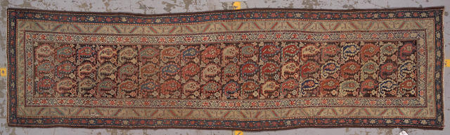 A Northwest Persian runner0 size approximatley 3ft. x 11ft. 6in.
