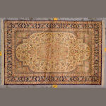 A silk Qum rug  Central Persia, size approximately 3ft. 4in. x 5ft. 1in.