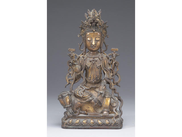A cast bronze figure of Manjusri Ming Dynasty