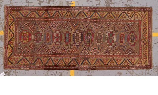A Kurdish runner Caucasus, size approximately 3ft. 4in. x 8ft.