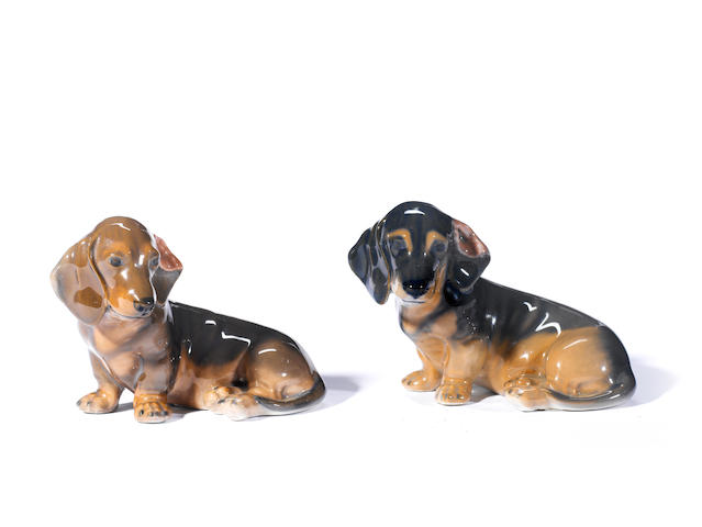 A pair of Royal Copenhagen porcelain figures in the form of Dachshund puppies height 3 in. (7.6 cm.)