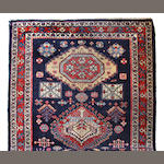 A Northwest Persian runner size approximately 2ft. 11in. x 17ft. 10in.