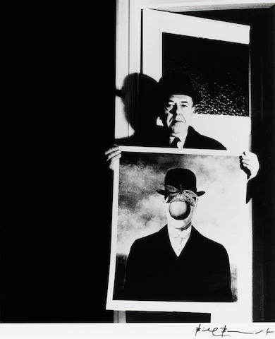 Bill Brandt (British, 1904-1983); René Magritte with his picture 'The Great War';