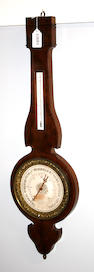 A Charles X inlaid mahogany weather station  second quarter 19th century