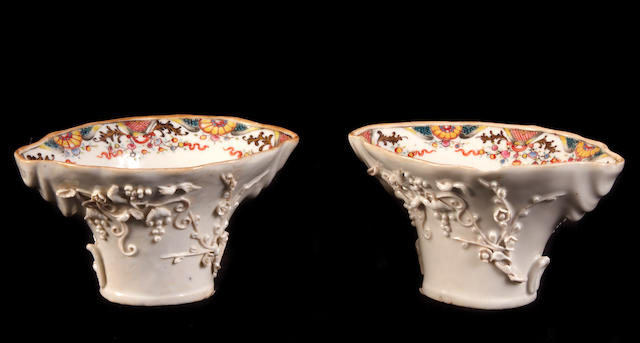 A pair of Chinese molded and enameled porcelain libation cups