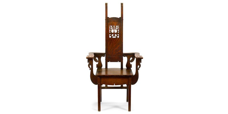 A Charles Rohlfs oak armchair