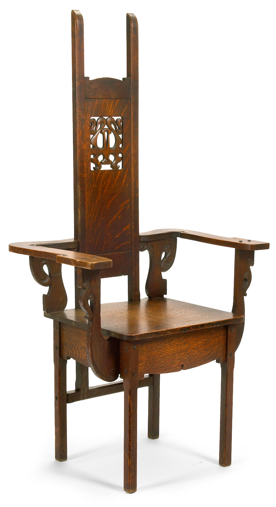 A Charles Rohlfs carved oak armchair