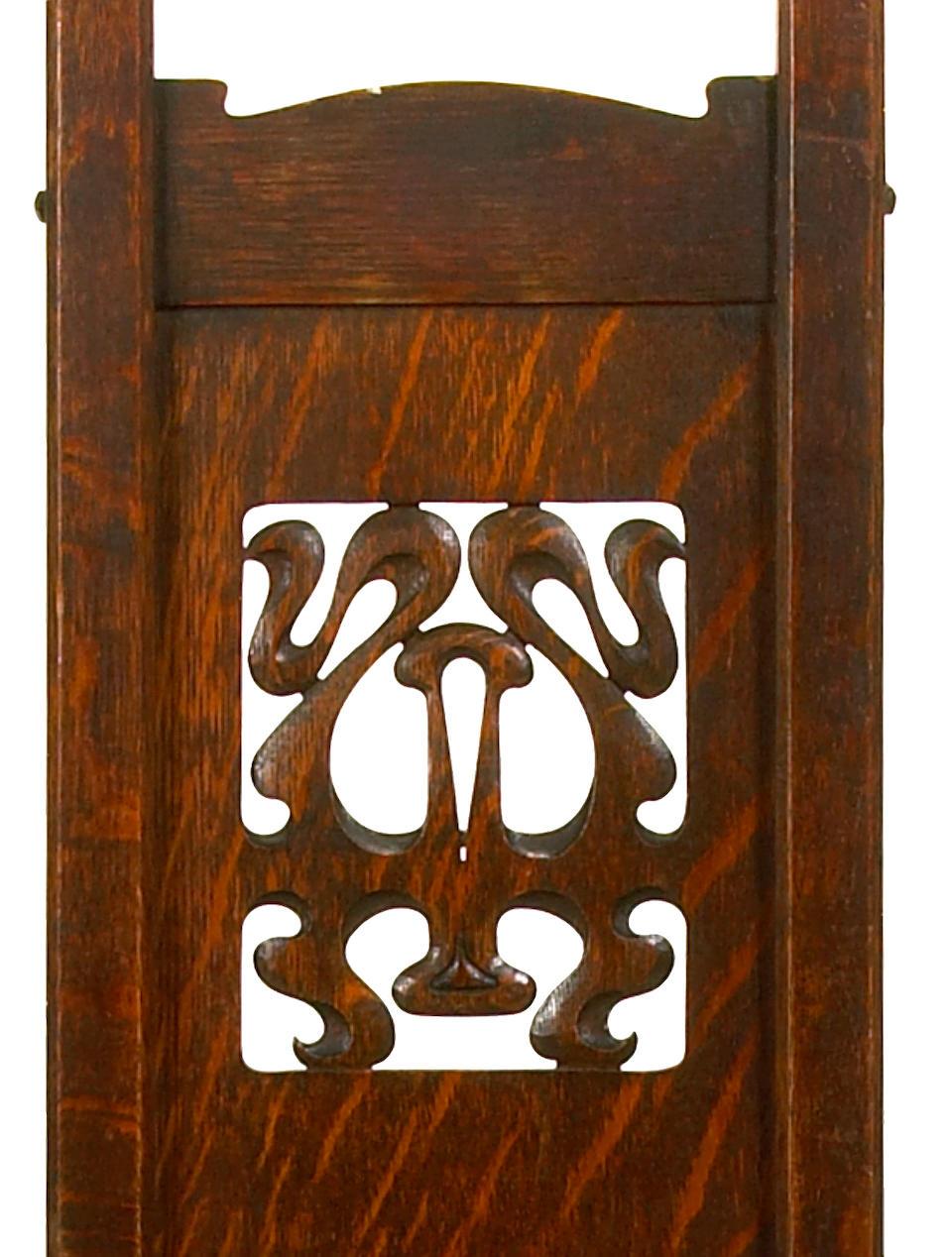 Bonhams : A Charles Rohlfs carved oak armchair