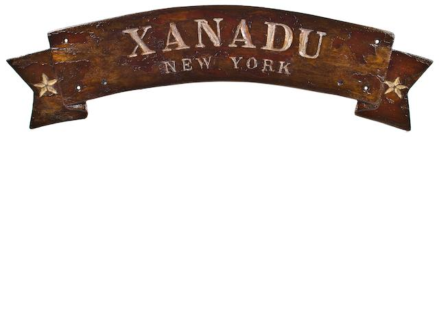 "A sternboard with the ship name ""XANADU NYC"""