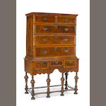 A William & Mary walnut chest on chest
