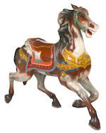 An American carved giltwood and painted carousel horse on stand<BR />attributed to Charles Looff, Brooklyn, New York<BR />circa 1900