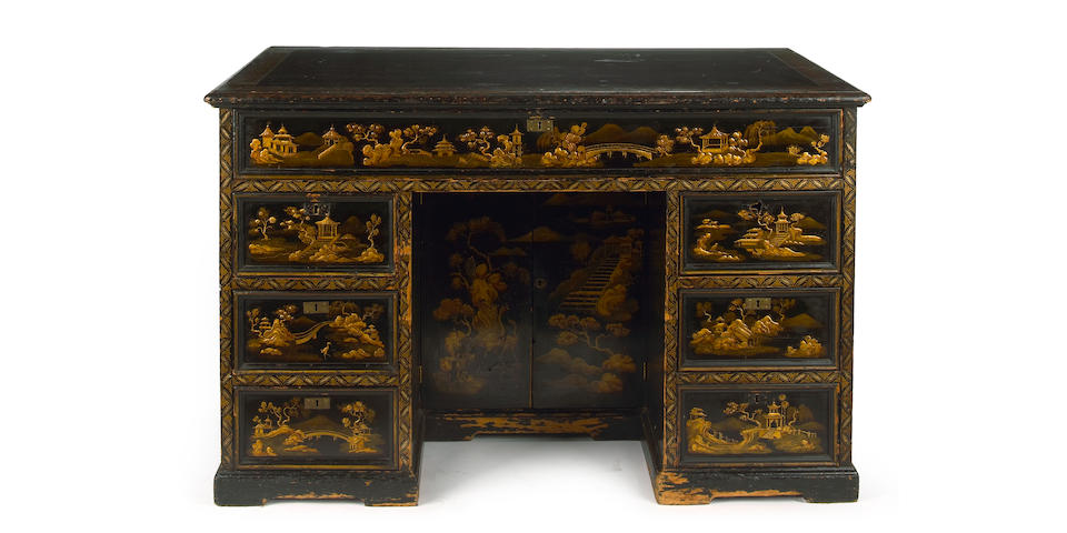 A George III style japanned kneehole desk