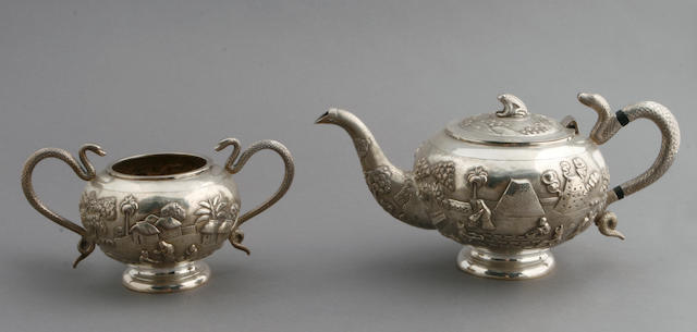 Indian export silver small three piece tea set with snake form handles and landscape decoration