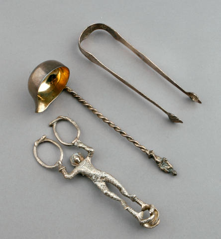 A Scottish Victorian silver pair of Harlequin form sugar nips