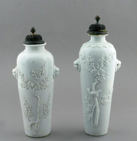 A pair of Chinese blanc de chine porcelain garniture vases