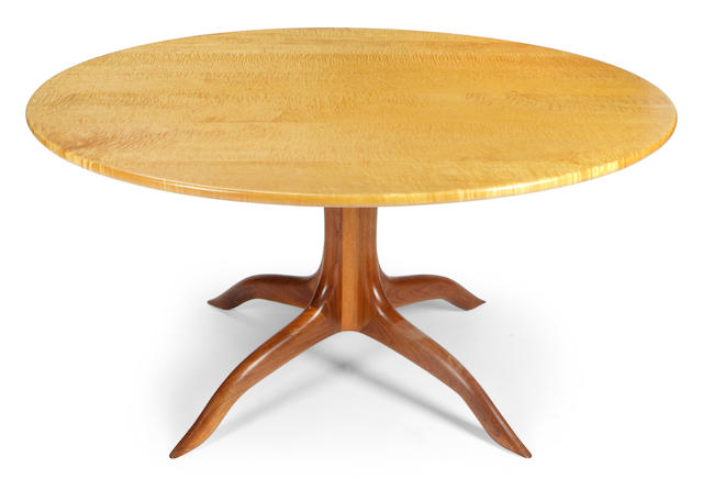 A Sam Maloof fiddle back maple and walnut circular table and four walnut spindle chairs 1990