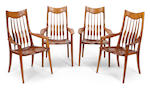 A Sam Maloof fiddle back maple and walnut round table and four spindle chairs