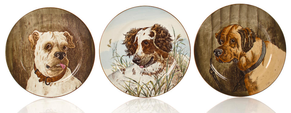 Group of six ceramic dog plates