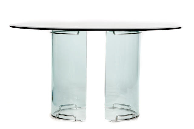 A contemporary glass and chromed metal dining table