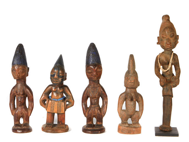 A group of Yoruba wood figures and mask