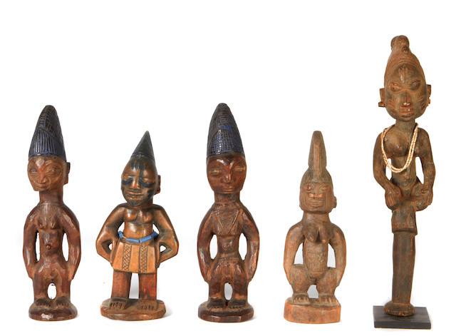 A group of Yoruba wood figures and mask