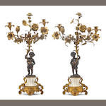 A pair of Napoleon III gilt patinated bronze and marble five light candelabra
