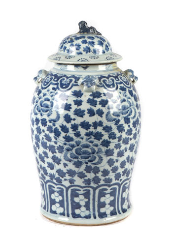 A large blue and white jar with top