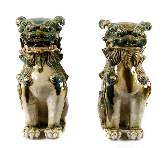 A pair of Chinese glazed ceramic figures of Buddhist lions