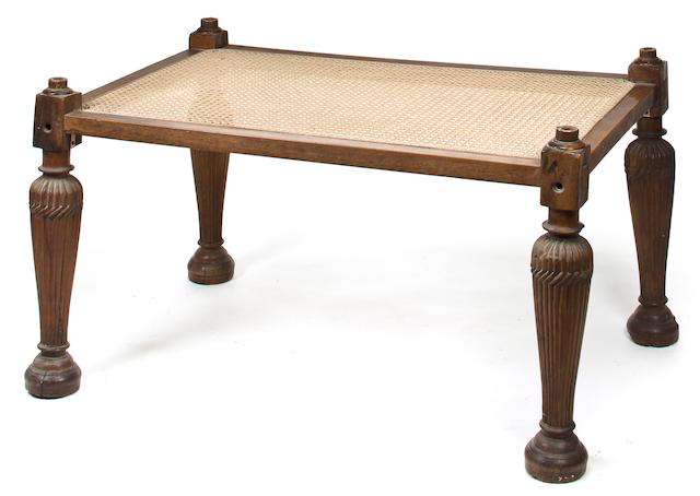 An Indian caned hardwood low table