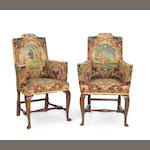 A pair of George I beechwood and walnut tapestry upholstered armchairs, early 18thc.