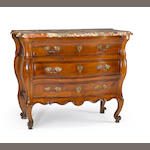 A Louis XV bronze and brass mounted walnut commode en tombeau, mid 18th century (repairs and restorations to breaks in the marble top)