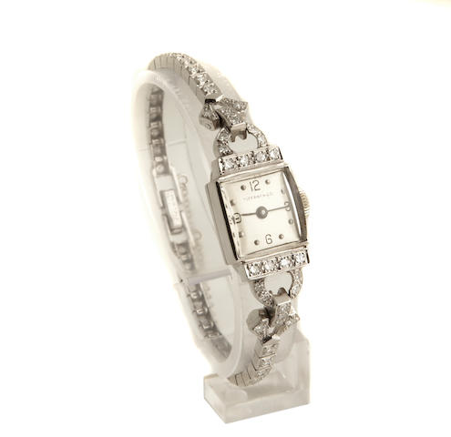 A diamond and platinum ladies wristwatch, Tiffany & Co with Movado movement, with extra links